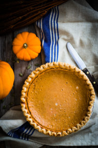 Pumpkin pie on rustic background