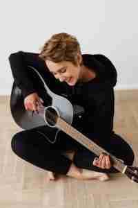 Woman enjoying playing guitar