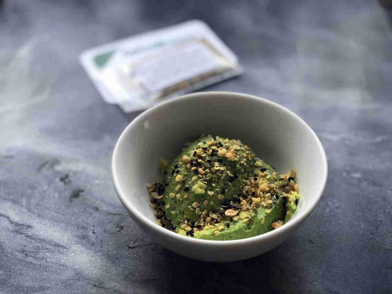 flax seeds sprinkled onto avocado